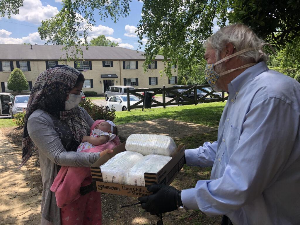 Doug distributing diapers